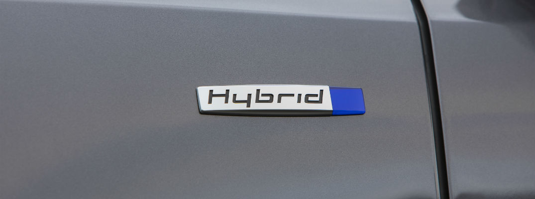 A close up photo of a hybrid badge on the 2018 Acura MDX Sport Hybrid