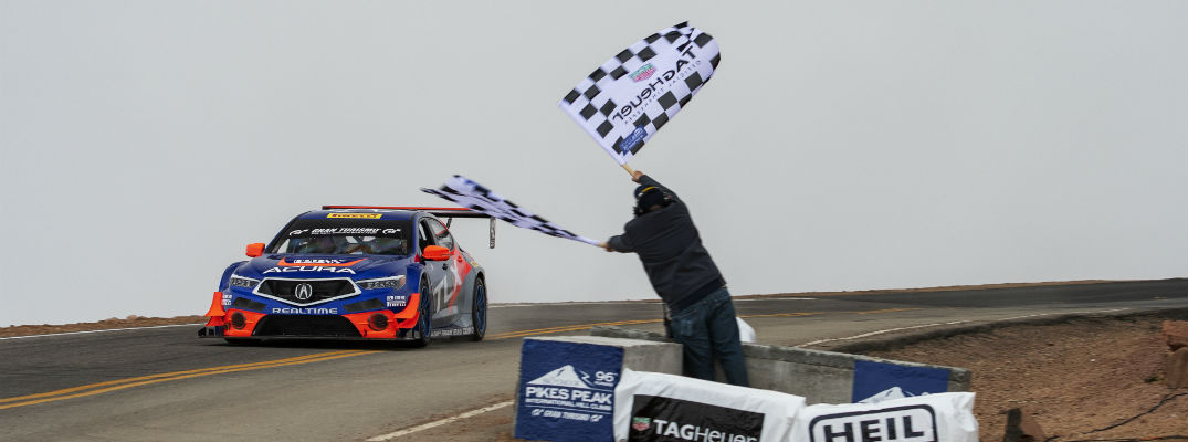 A photo an Acura race vehicle crossing the Pikes Peak finish line.