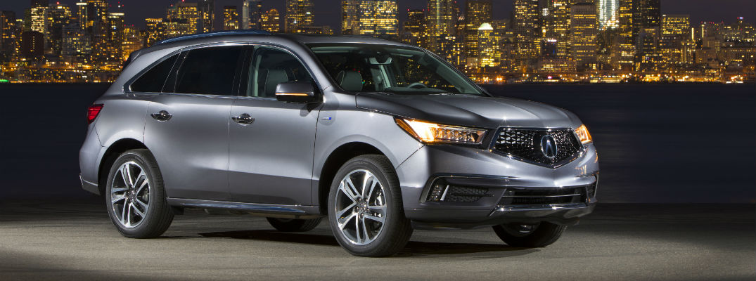 A right profile photo of the 2019 Acura MDX Sport Hybrid in front of a city skyline.