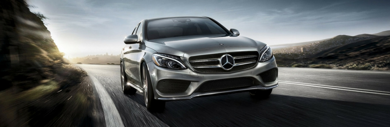 2018 Mercedes-Benz C-Class Sedan driving down road