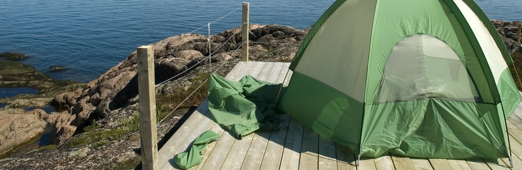 Tent set up on a dock overlooking water