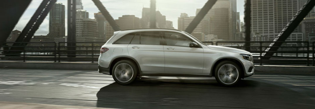 Driver side exterior view of a white 2018 Mercedes-Benz GLC SUV