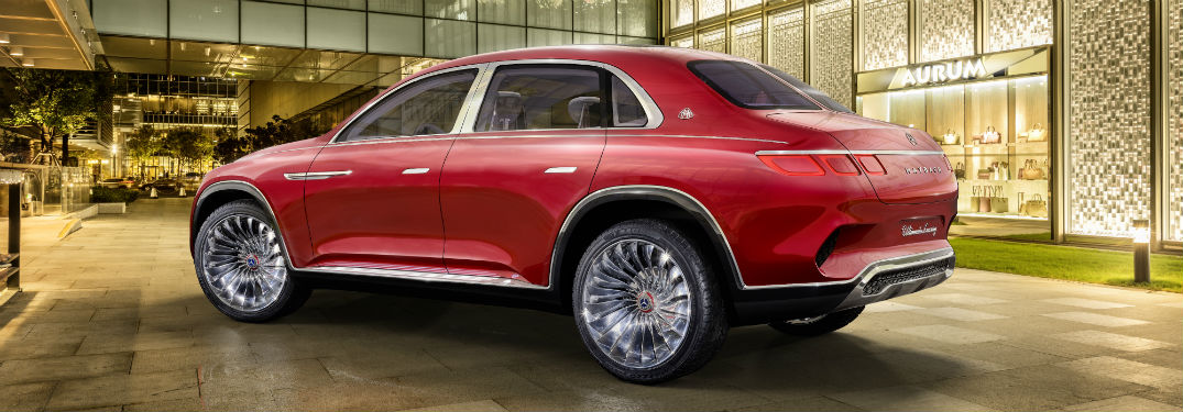 Driver side exterior view of a red Vision Mercedes-Maybach Concept