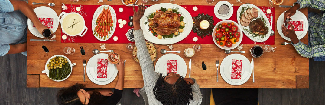 people sitting at a table for thanksgiving