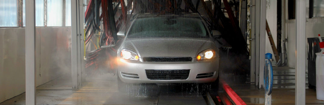car driving through car wash