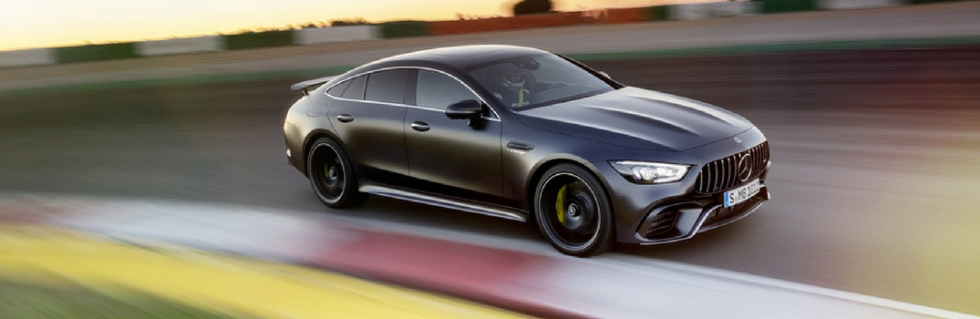 Mercedes-AMG GT 4-Door Coupe speeding down the road