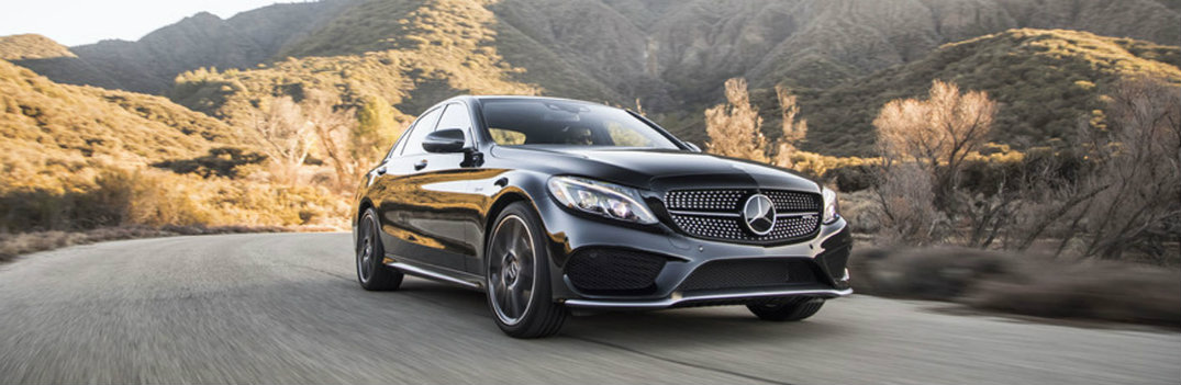2018 Mercedes-Benz C-Class black driving on the highway hilly background