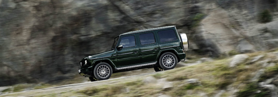 right side of dark green mercedes-benz g-class