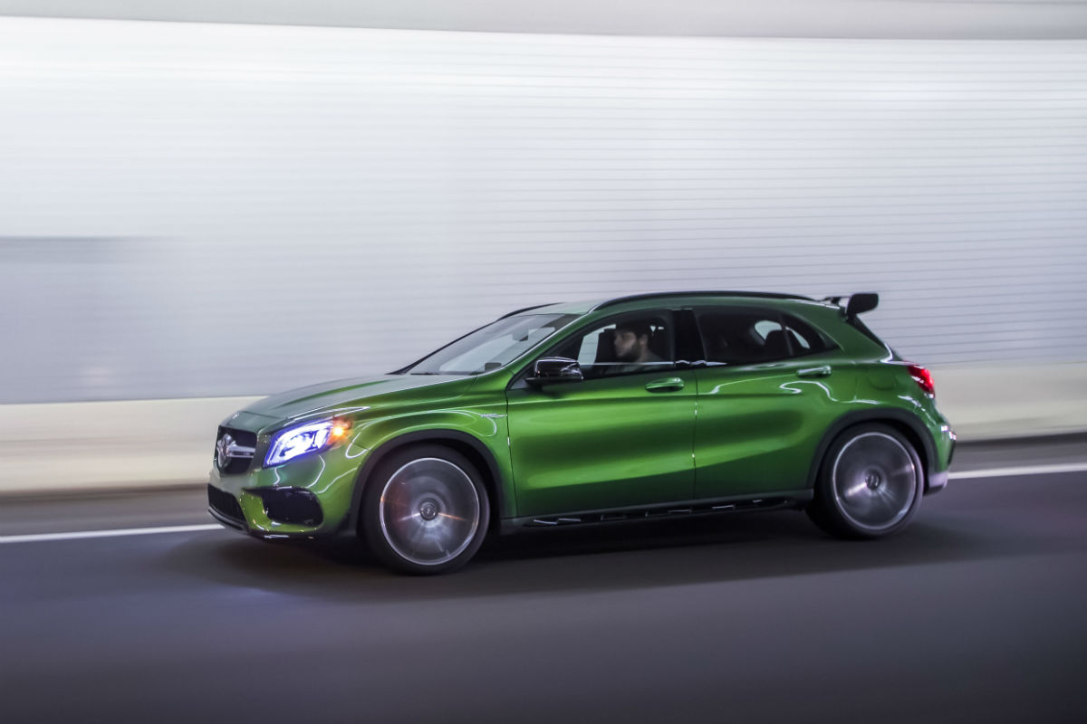 Driver side view of a green 2018 AMG GLA45