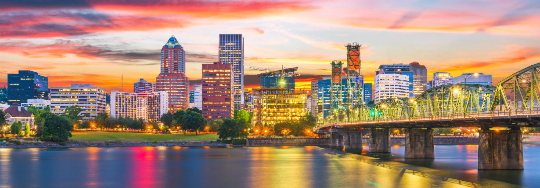 city skyline and river of portland at sunset