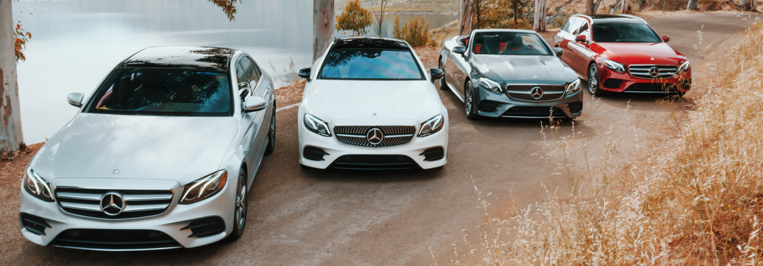 four 2019 E-Class models lined up next to water