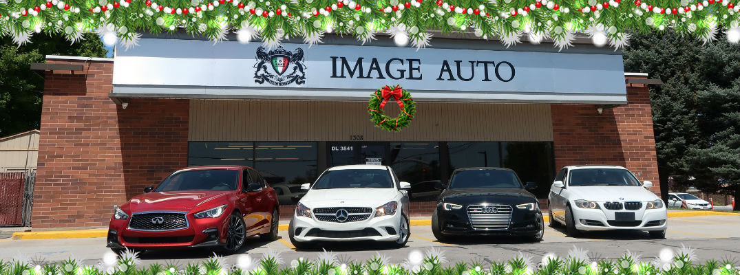 A holiday photo illustration of the Image Auto Sales building.