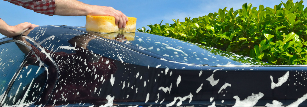 sponge washing car outside