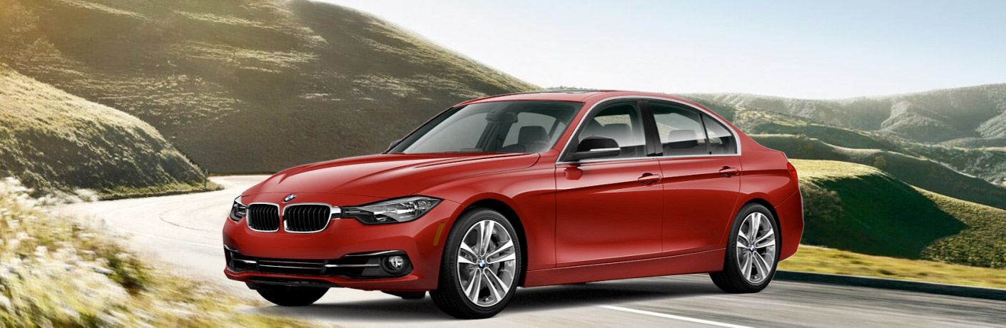2017 bmw 3 series red parked