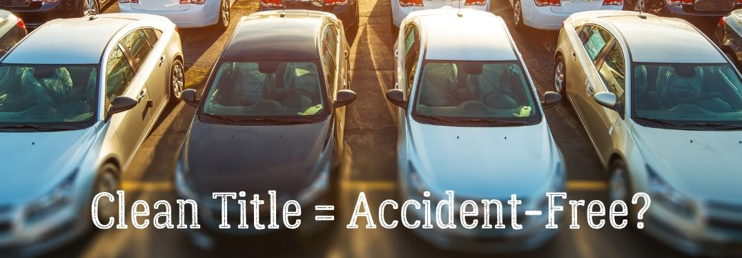 Clean Title = Accident-Free? text with rows of cars in background
