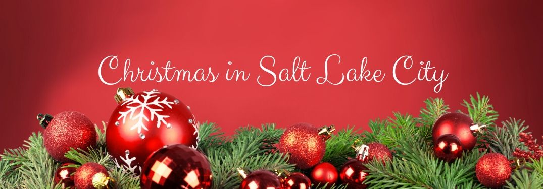 Christmas in Salt Lake City text with a red background featuring ornaments and evergreen branches