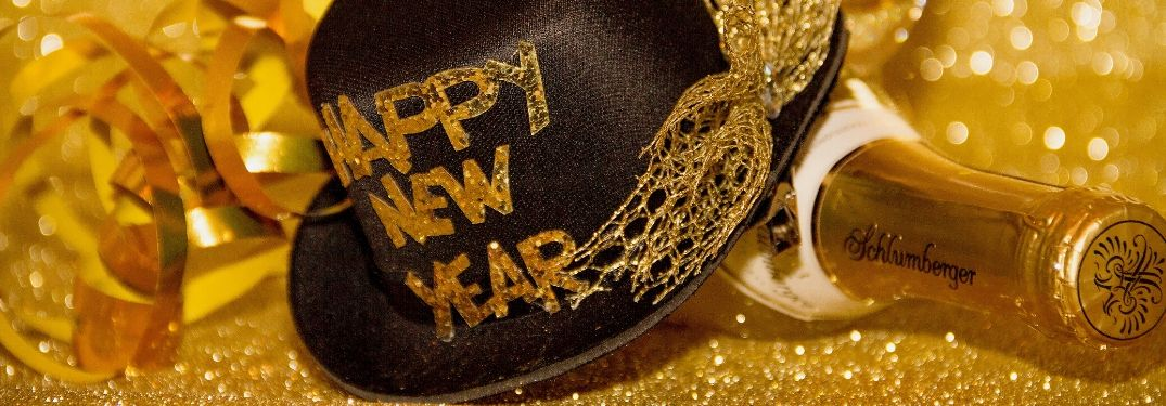 Happy New Year hat with champagne bottle