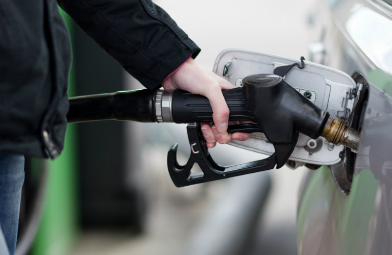 closeup of person filling car with gas