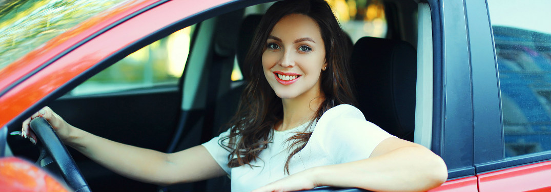 woman looking out of car and smiling