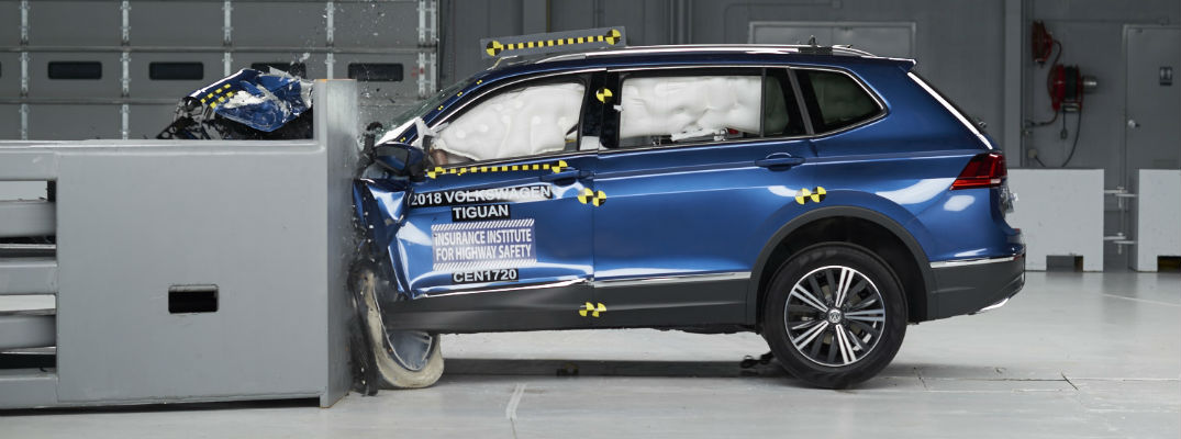 Photo of a 2018 Volkswagen Tiguan as it strikes a barrier during crash testing