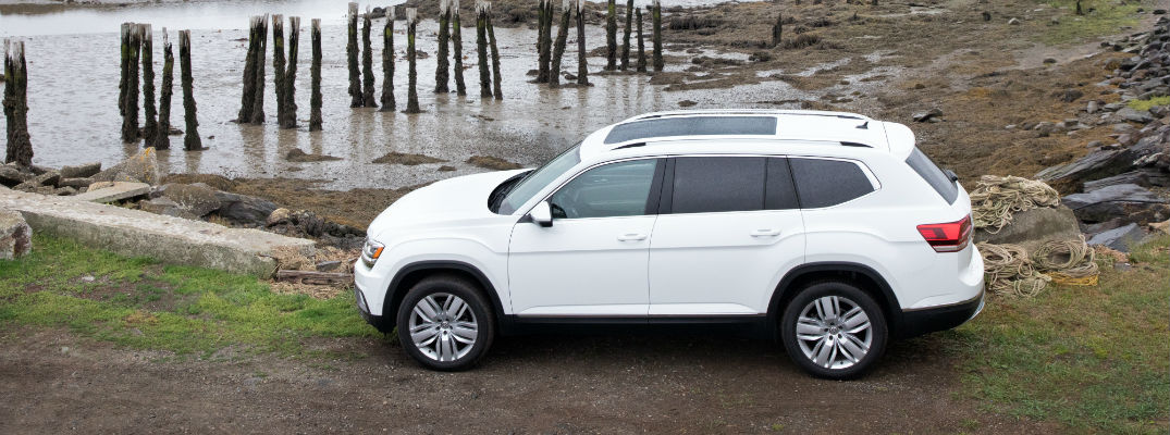 A left profile view of a white 2018 Volkswagen Atlas available at Spitzer VW