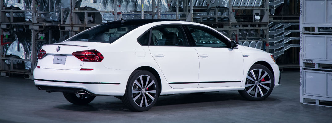 A right profile view of the 2018 Volkswagen Passat GT parked in the factory