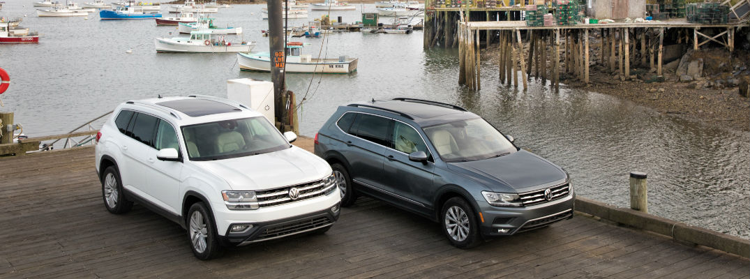 A photo of a 2018 VW Atlas and 2018 VW Tiguan on a dock by the bay