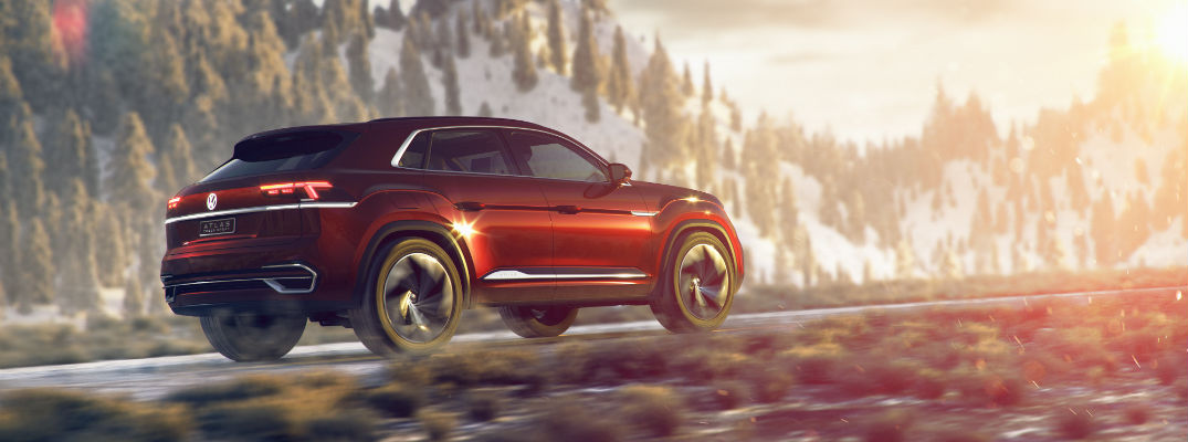 A right profile photo of the Volkswagen Atlas Cross concept vehicle on a mountain road.