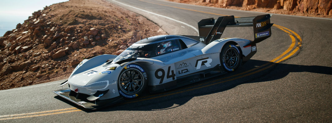 A photo of the VW ID R Pikes Peak car making a turn on the track.