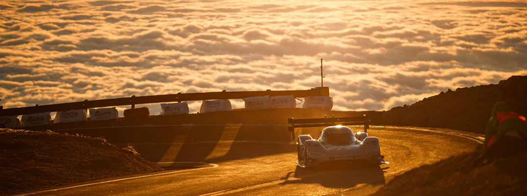 A photo of the VW Pikes Place car breaking through the clouds at the annual race.