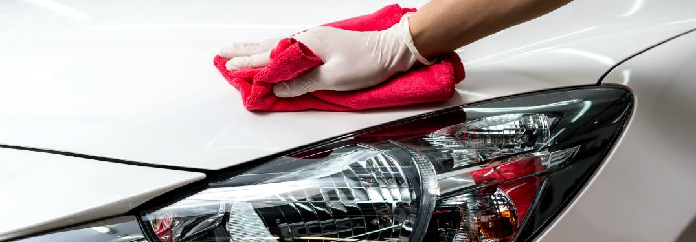 driver wiping down their car hood
