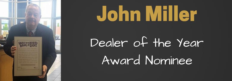 john miller holding poster for dealer of the year nomination
