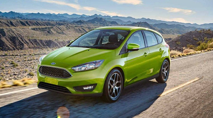 Green 2018 Ford Focus Hatchback parked on open road
