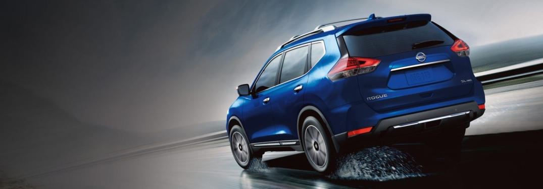 Blue 2019 Nissan Rogue driving through rain