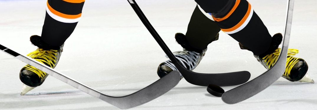 Close up of hockey players playing on ice