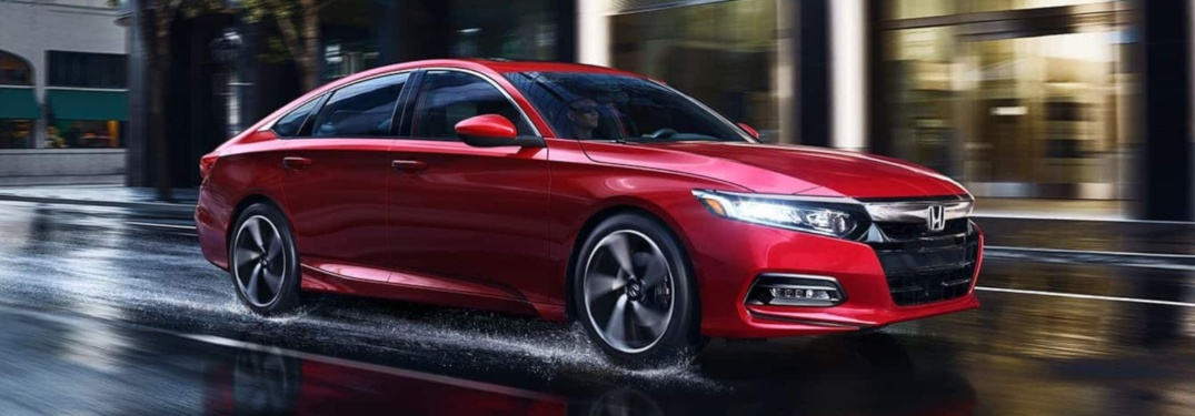 Red 2019 Honda Accord driving on wet street