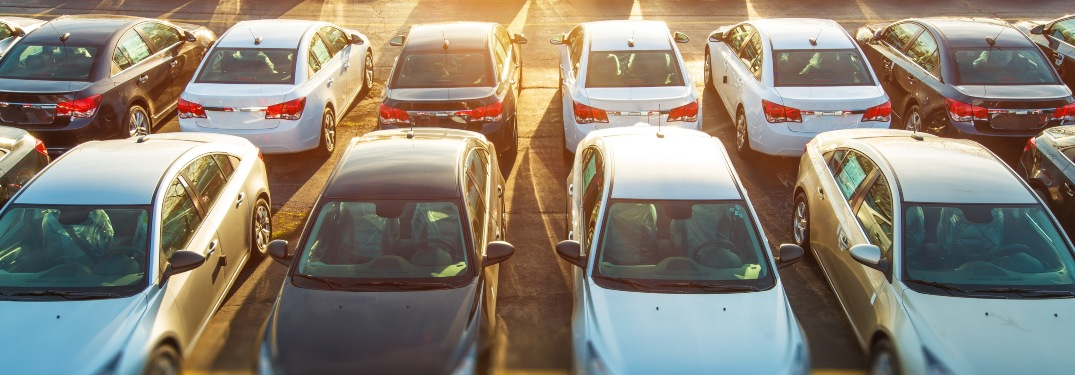 Overhead look of sedans in a parking lot