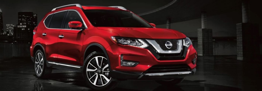 Red 2019 Nissan Rogue on a black background