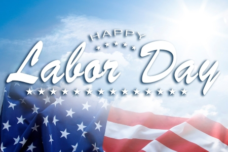 Happy Labor Day text on sky background above American flag