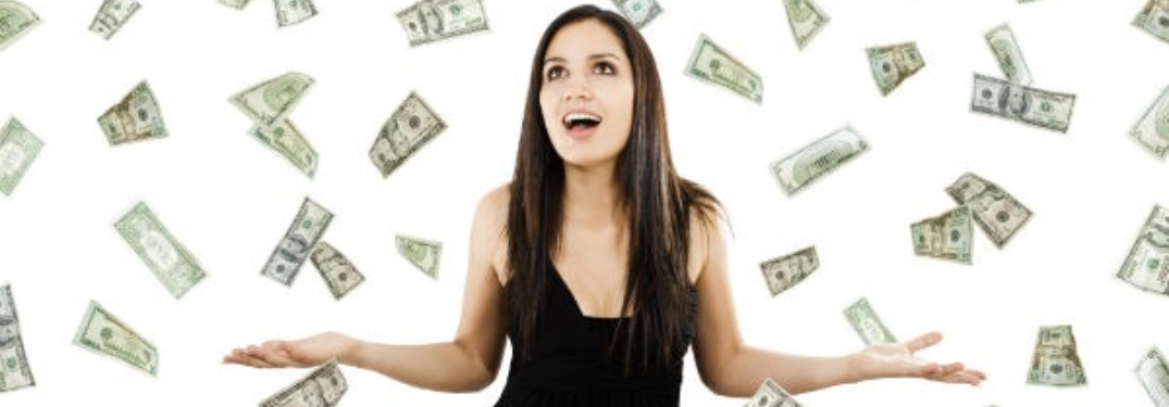 Money falling down around woman