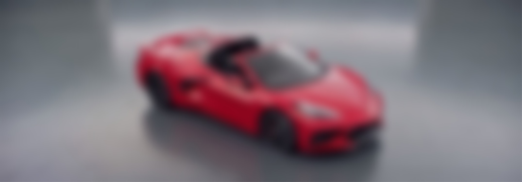 Blurred out image of a red 2020 Chevy Corvette