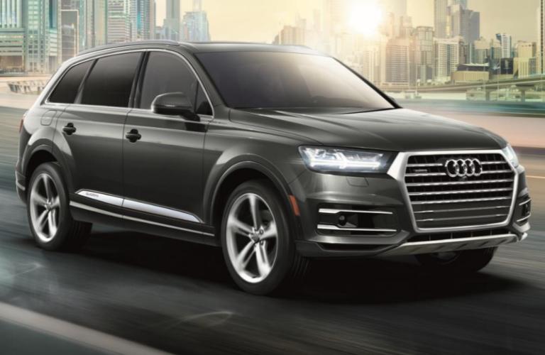 2019 Audi Q7 driving down the street