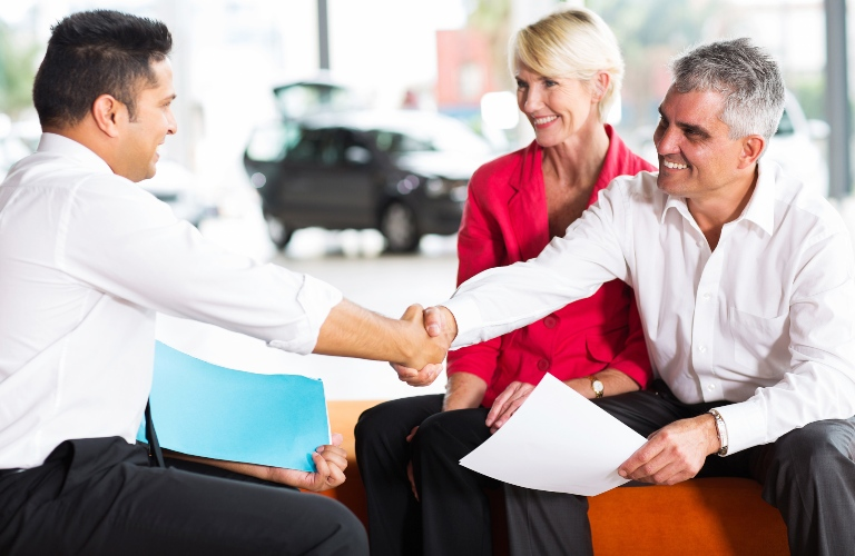 Salesman and customer shaking hands