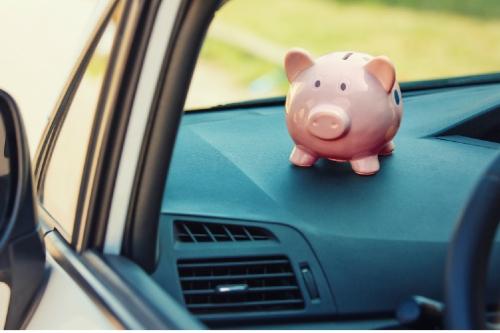 piggy bank sitting a dashboard