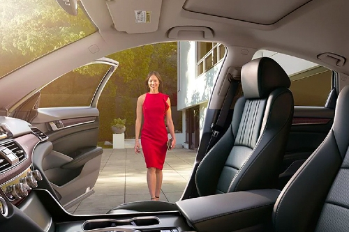 Woman walking toward open door of 2020 Honda Accord
