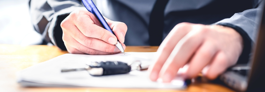 Person signing auto loan