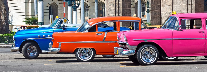 three bright classic cars in Havana, Cuba