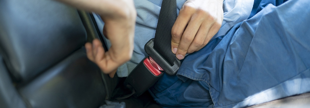 person buckling up