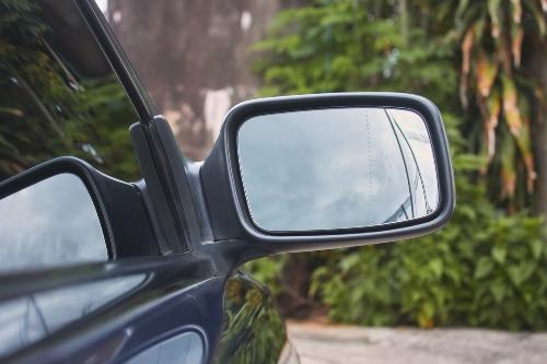 close up on passenger mirror of car