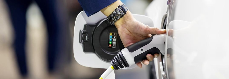 person charging EV